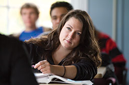 Photo of a student in class. Link to Life Stage Gift Planner Under Age 60 Situations.