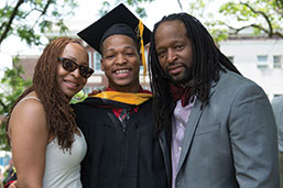 Photo of a graduate with parents. Link to Life Stage Gift Planner Ages 60-70 Situations.